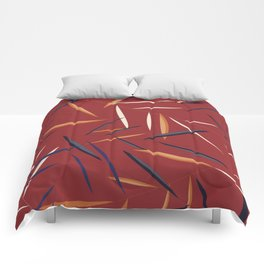Leaves in a red background Comforters