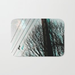 hanging by a string Bath Mat