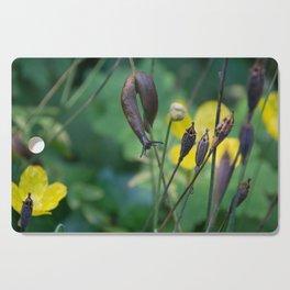 slug dancing on a poppy Cutting Board