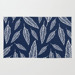 Dark blue and white falling feathers Rug