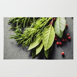 Herbs and spices on slate background Rug