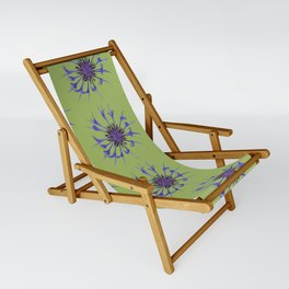 Thin blue flames in a sea of green Sling Chair