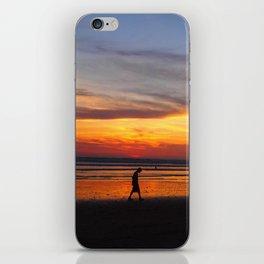 Boy alone at sunset iPhone Skin