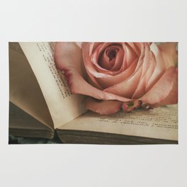 Still life with pink rose and old books Rug