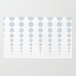 Up and down polka dot pattern in white and a pale icy gray Rug