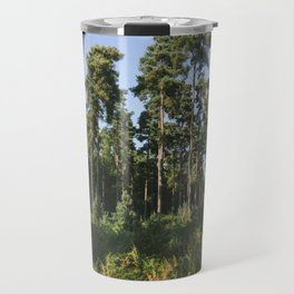 Sunlight through forest of Pine trees (Pinus sylvestris). Thetford, Norfolk, UK. Travel Mug