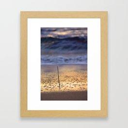 Sea and a stick Framed Art Print