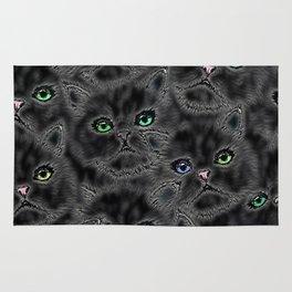 Black Kitten Faces Rug