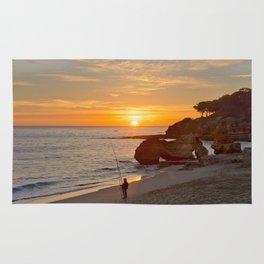 sunset fisherman, Portugal Rug
