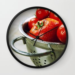 fresh tomatoes (in metal colander) and herbs on a wooden table Wall Clock