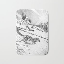 Snowboarder and snow leopard down the slope Bath Mat