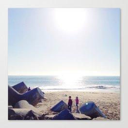 Children at beach; California coast; blue sky; winter sunshine. Canvas Print
