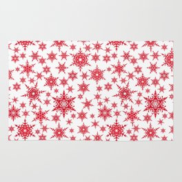 Red snowflakes on white. Rug