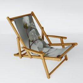 The fragile start of spring Sling Chair