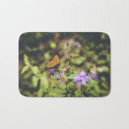 Butterfly on the wild flowers Bath Mat