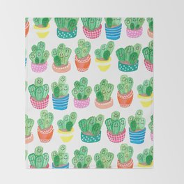 Cacti in fancy pots with smily faces. Throw Blanket