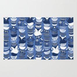 Swedish folk cats I // Indigo blue background Rug