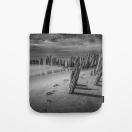 Footprints and Pilings on the Beach in Black and White at Kirk Park by Grand Haven Michigan Tote Bag