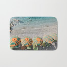 Umbrellas on the beach Bath Mat