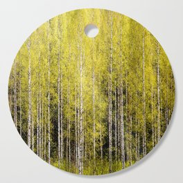 Lovely spring atmosphere - vibrant green leaves on the trees - beautiful birch grove Cutting Board