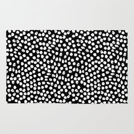 Black and white dots minimal linocut pattern graphic scandi design Rug