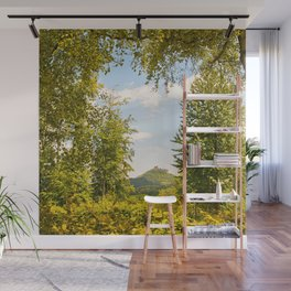 Trifels castle framed by green trees Wall Mural
