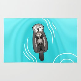 Mother and Pup Sea Otters - Mom Holding Baby Otter Rug