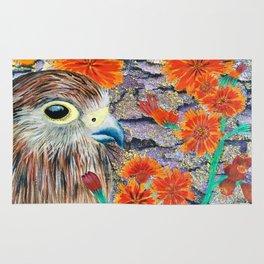 Baby Hawk with orange flowers Rug