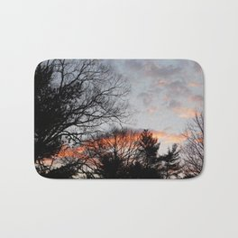 red clouds in the sky Bath Mat