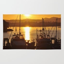 Sunset And The Boats Rug