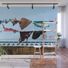 Hanging laundry in blowing wind Wall Mural