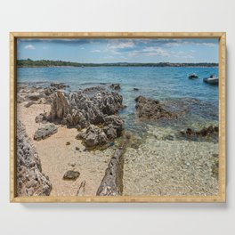 Pathway on the beautiful rocky beach in Istria, Croatian coast. Blue transperent sea, sky and island Serving Tray