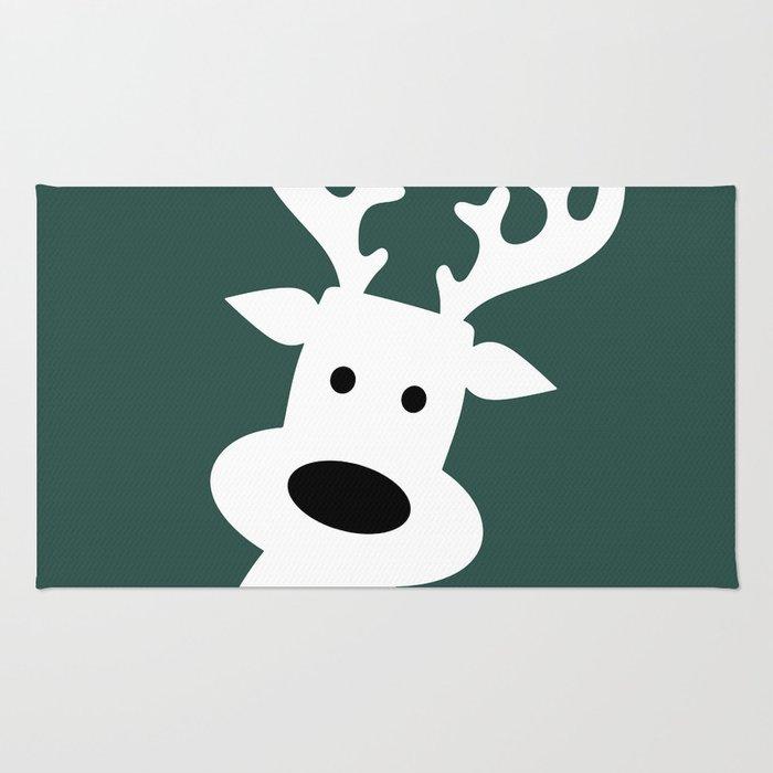 Reindeer on green background Rug