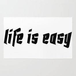 Life is easy black on white background Rug