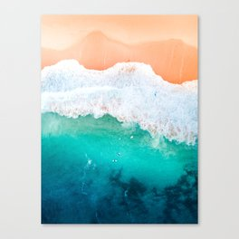 Tiny Surfers in the Blue Ocean Canvas Print