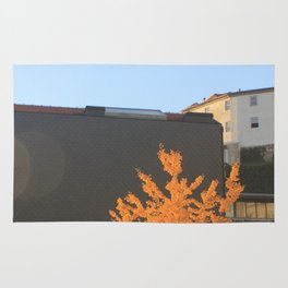 Yellow tree in the city Rug