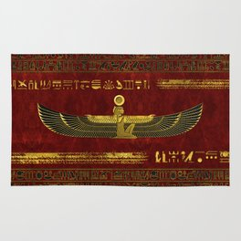 Golden Egyptian God Ornament on red leather Rug