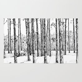 A fox in pine forest Rug