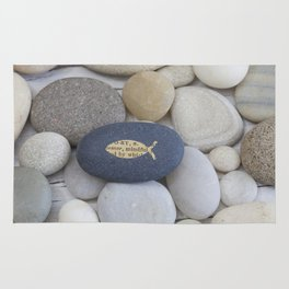 Mindful fish symbol on pebble Rug