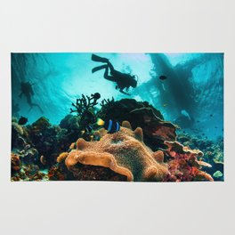 Colourful seascape with diver silhouette Rug