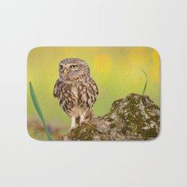 A little owl with a grasshopper. Bath Mat