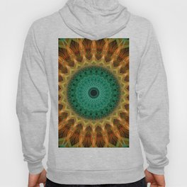 Mandala with green, brown and golden ornaments Hoody