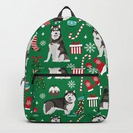 Alaskan Malamute dog christmas pattern candy canes christmas presents Backpack