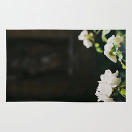 White Florals Flowers Against A Dark Background Negative Space Composition Rug