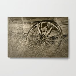 Sepia Toned Photo of an Old Broken Wheel Metal Print
