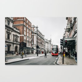 Red bus in Piccadilly street in London Canvas Print