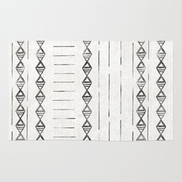 Tribal Block Print 2, in black with a diamond and dashed pattern over an off white background Rug