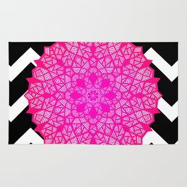 Bright pink design on black and white chevron pattern Rug