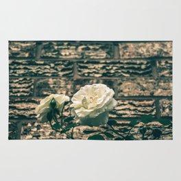 The moody garden flowers Rug