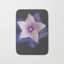 Two flowers in one Bath Mat